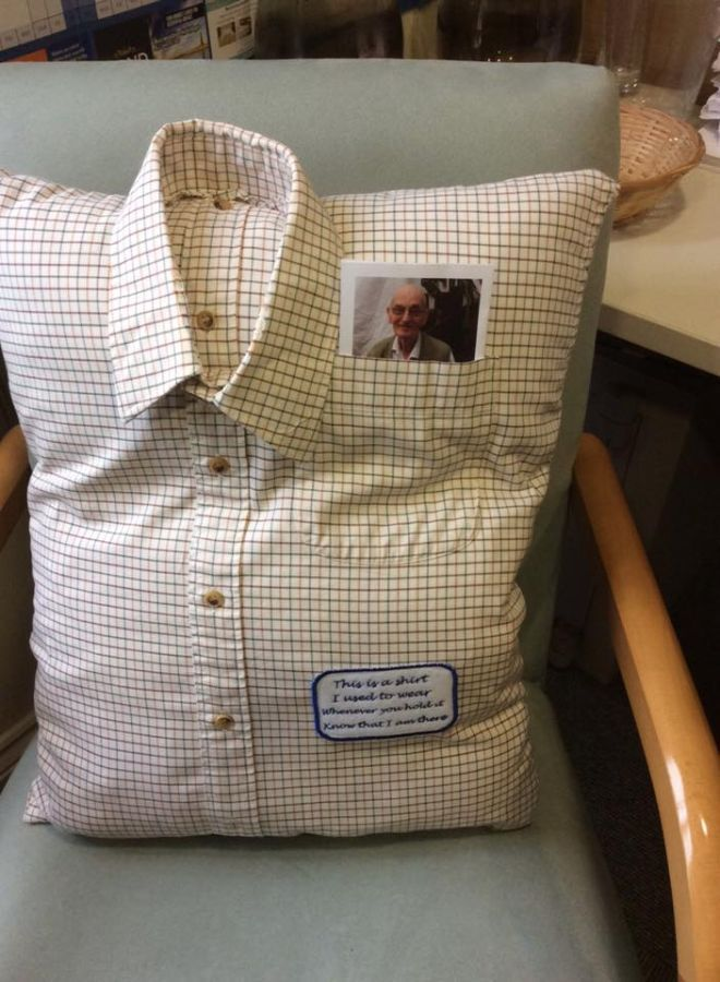 Retirement home staff member gives elderly widow a memory cushion for comfort
