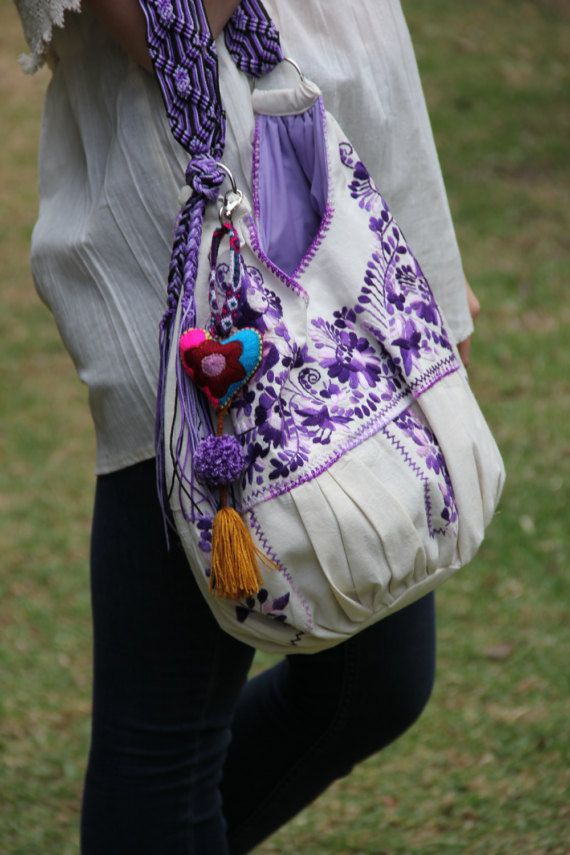 This hand embroidered piece from or Puebla collection is fun! The cross bag handle is a handwoven masterpiece. In this series you will see the strap double tied for a shorter version of the cross body. It can be worn both ways. The hand embroidery work on the bag is exquisite. It is lined
