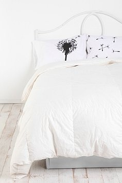 urbanoutfitter.com has all kinds of connected theme pillowcases including a mustache... definitely worth checking out. I settled on the dandelion.