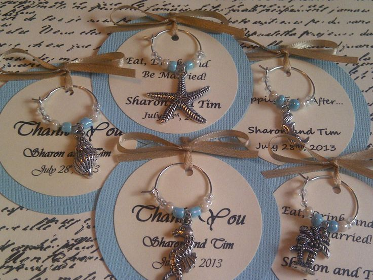Custom Beach Themed Wine Charm Favors - Weddings, Bridal Shower, Rehearsal Dinner, Anniversary, Birthday Party, Dinner Party, Special Event by FromAppalachia on Etsy https://www.etsy.com/listing/155124765/custom-beach-themed-wine-charm-favors