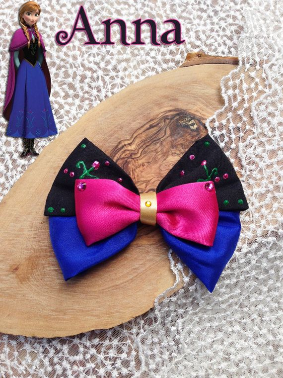 Disneys Anna inspired hair bow. Measures about 4.5 across.    This bow is hand sewn, hand painted with puffy paint, and rhinestoned by hand. All