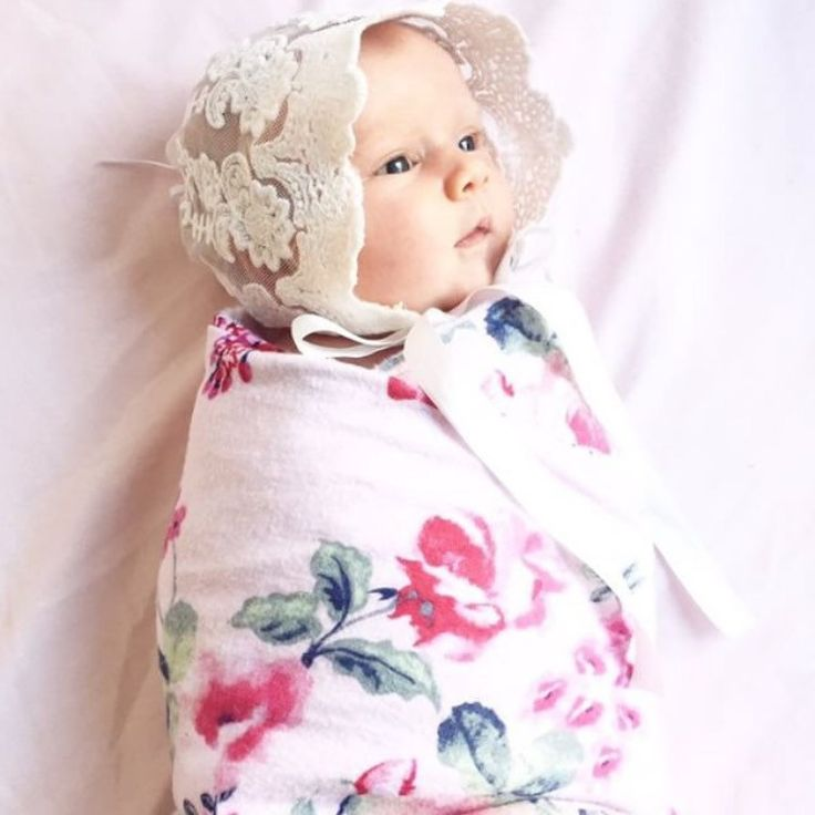 Hold onto your ovaries ladies 😍 How gorgeous is Daisy in this stunning @redtreepompoms bonnet and swaddled in our Fleur Newborn Baby Blanket 💕Available online now! 📷 @hazelbaby_soycandles