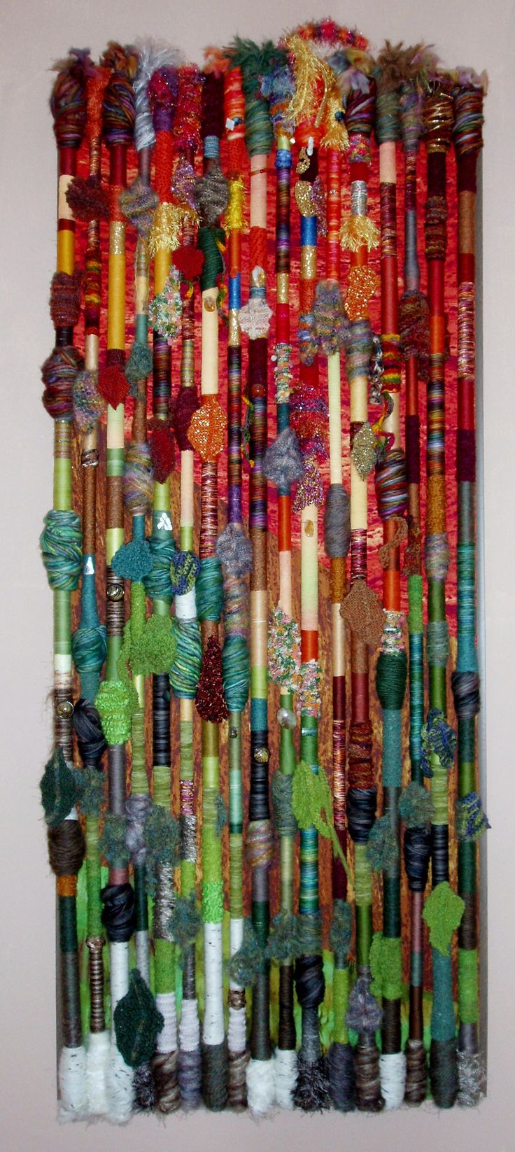 Fiber Art Wall Hanging - Fall in the Northland. Made by Polly Tracey with an assortment of wool yarn, fabric, buttons and free form crochet.