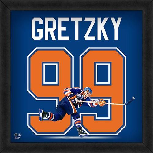 Featured is a Wayne Gretzky framed Edmonton Oilers jersey photo. This photo has been professionally framed and is approximately 20x20. **Note: This photo is not signed.**