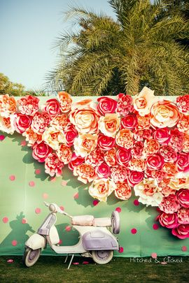 Sangeet Decor - Karan & Ridhima | WedMeGood | Paper Floral Decor with a White Scooter #wedmegood #indianbride #indianwedding #decor #paperdecor #mehendidecor #sangeetdecor #floral #weddingdecor