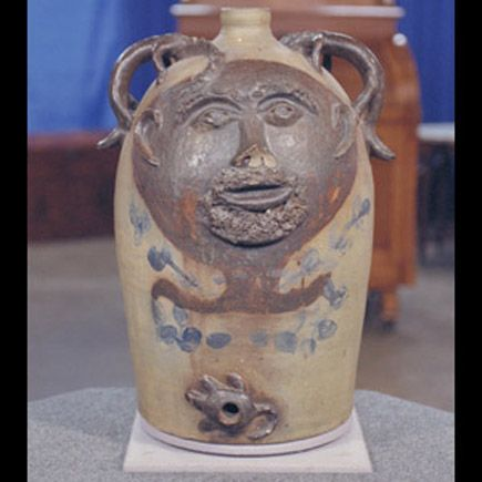 19th-Century Folk Art UGLY 20 gallon Jug from Antique Roadshow. Purchased at a yard sale along with a bee sting for 52.50. Value... 30 to 50 thousand dollars!