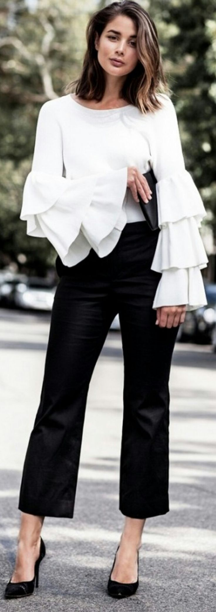 Style Tip: Pair tiered ruffled sleeves with a pair of smart trousers and pumps