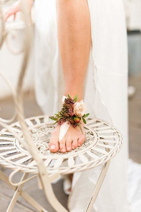 Having a beach or destination wedding? Opt for no bridal shoes! This flower inspired ribbon is gorgeous for the barefoot bride. You won't have to worry about getting sand in your shoes and you can show off your cute pedicure!