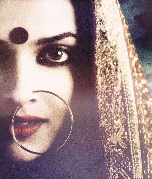 Big beautiful kohl lined eyes, dark red lips and the dramatic nose ring <3 #indianbride