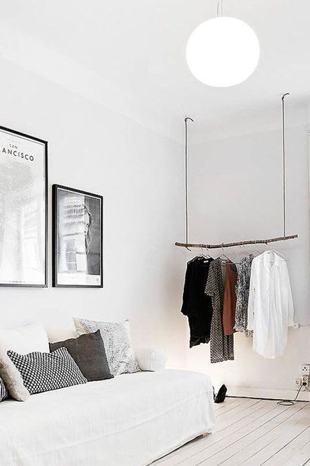 Bedroom with hanging rail for clothes