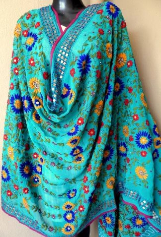 Gorgeous phulkari work georgette dupatta is in a unique shade of green, with heavy embroidery. It has been hand embroidered in a vibrant colored floral pattern, with wool thread and sequins - See more at: http://giftpiper.com/Handembroidered-Phulkari-Work-Georgette-Dupatta-Green-id-278821.html#sthash.do7lOY2W.dpuf