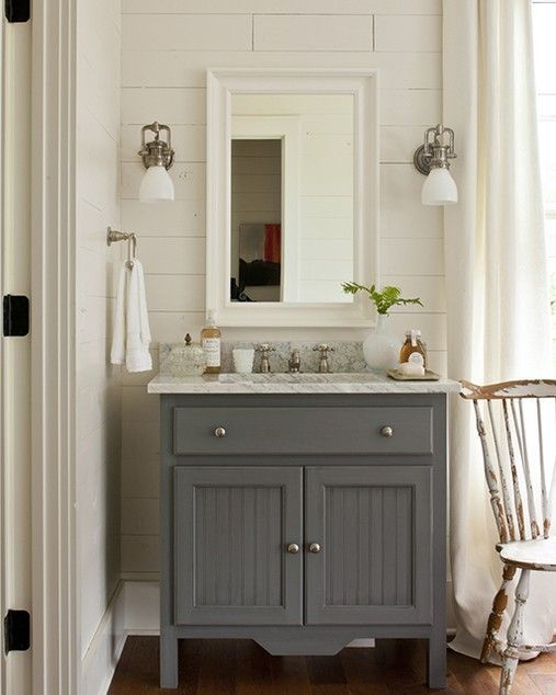Cottage bathroom vanity painted gray. Love the wood behind the mirrors