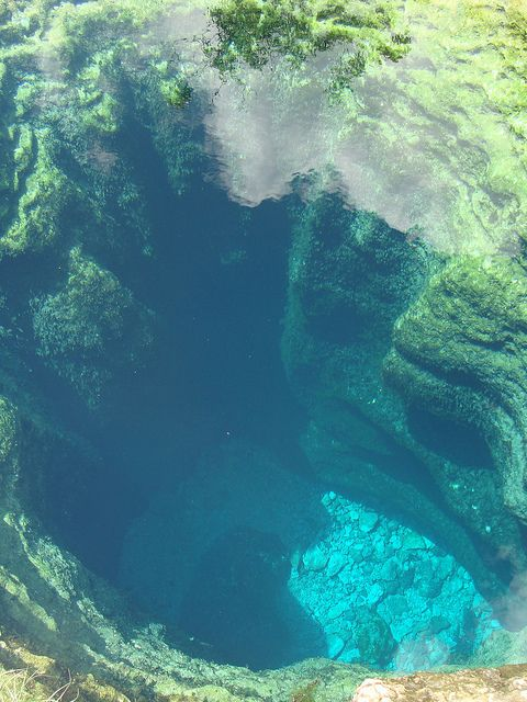 Jacob's Well in Wimberley, Texas. It's a significant karstic spring, the largest perennial spring in the Texas Hill Country. It flows from the most extensive underwater cave in Texas. 4m diameter mouth cave, descends vertically for about 10m, continuing from there at an angle as a series of chambers separated by narrow, often deeply silted and unstable necks, ultimately reaching a depth of at least 40m.