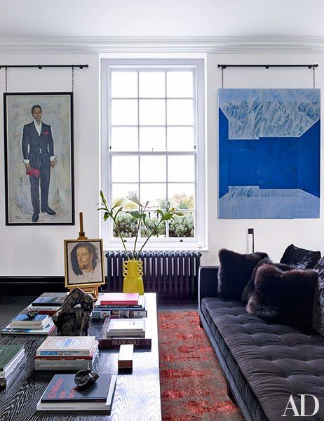 Framing a window in the TV area are a Robert Mulhern portrait of L'Roubi (left) and a painting by Hurvin Anderson; the small portrait and bronze sculpture are by Glyn Philpot, and the velvet-clad sofa is by B&B Italia.