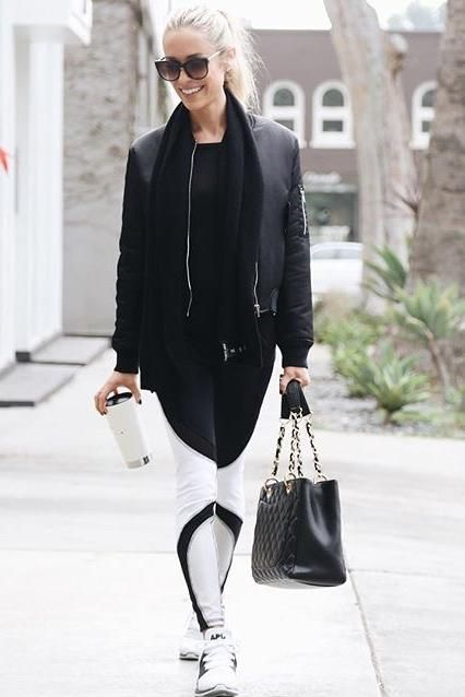 Kristin Cavallari wearing Chanel Caviar Gst Shopping Bag in Black, Thierry Lasry Anorexxxy Sunglasses, APL Ascend White Sneakers and Kookai Nikita Bomber Jacket