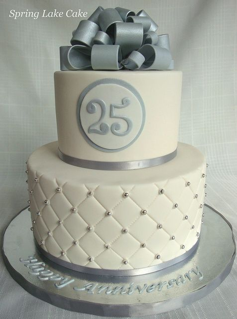 25th wedding anniversary cake with silver dragees and gumpaste bow.