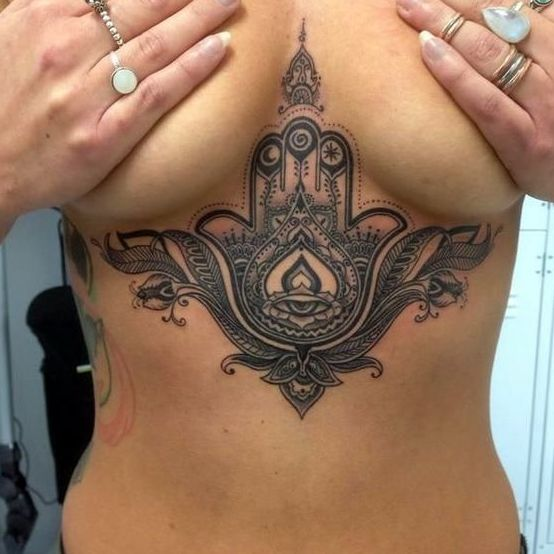 http://www.revelist.com/arts/underboob-tattoos/5179/The Hamsa Hand is said to bring you happiness, luck, health, good fortune — and amazing body art./7/#/7