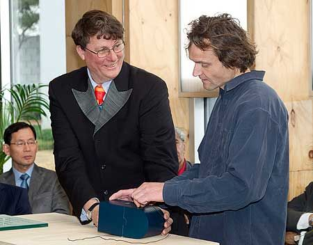 Sir Richard Taylor and Industrial Design Lecturer Matthijs Siljee compiling the time capsule to be opened in 50 years as part of the building opening for Te Ara Hihiko - the new College of the Creative Arts building.