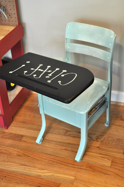 We found a wooden school desk and decided to paint it blue and chalk board paint on the desk. Then we found this on Pinterest!