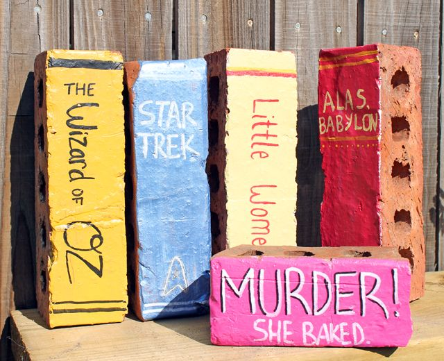 punk projects: Bricks painted to look like books. Would look lovely stacked in the garden.