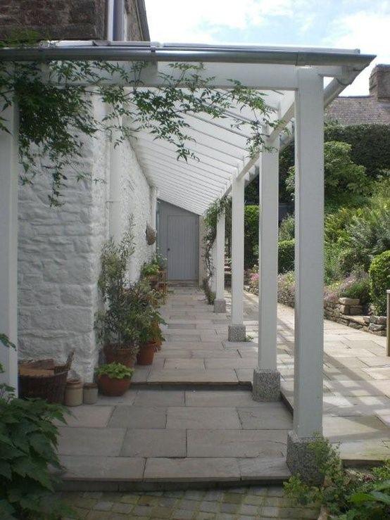 Vine walkway along side of house More