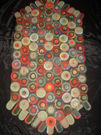 early pennies and peddles greyblack and red on a black cottonu2026 antique penny rug