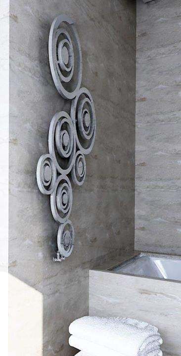 Both Stainless Steel Towel Radiator and handles belong to the line 'OH' designed by Beatriz Sempere