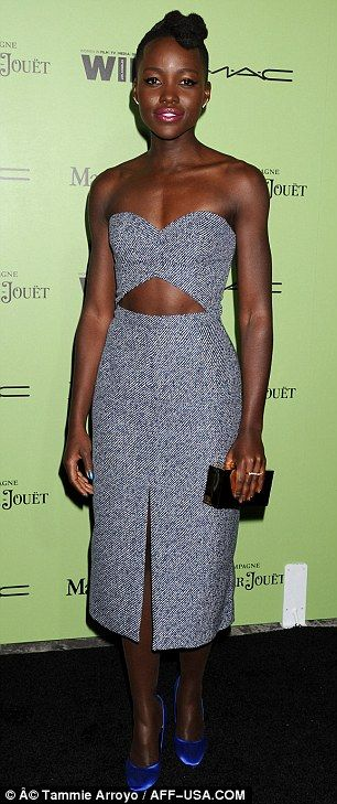 Best dressed @ 7th Annual Women in Film Pre-Oscar cocktail party | Lupita Nuong'o in a Michael Kors blue strapless dress with cut-out detailing styled with Pedro Garcia cobalt blue stain pumps & a brown box clutch
