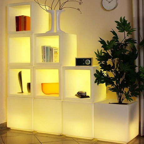 LED Stackable Cubes.  Could be used as storage or moveable seats.  Also a way to incorporate light