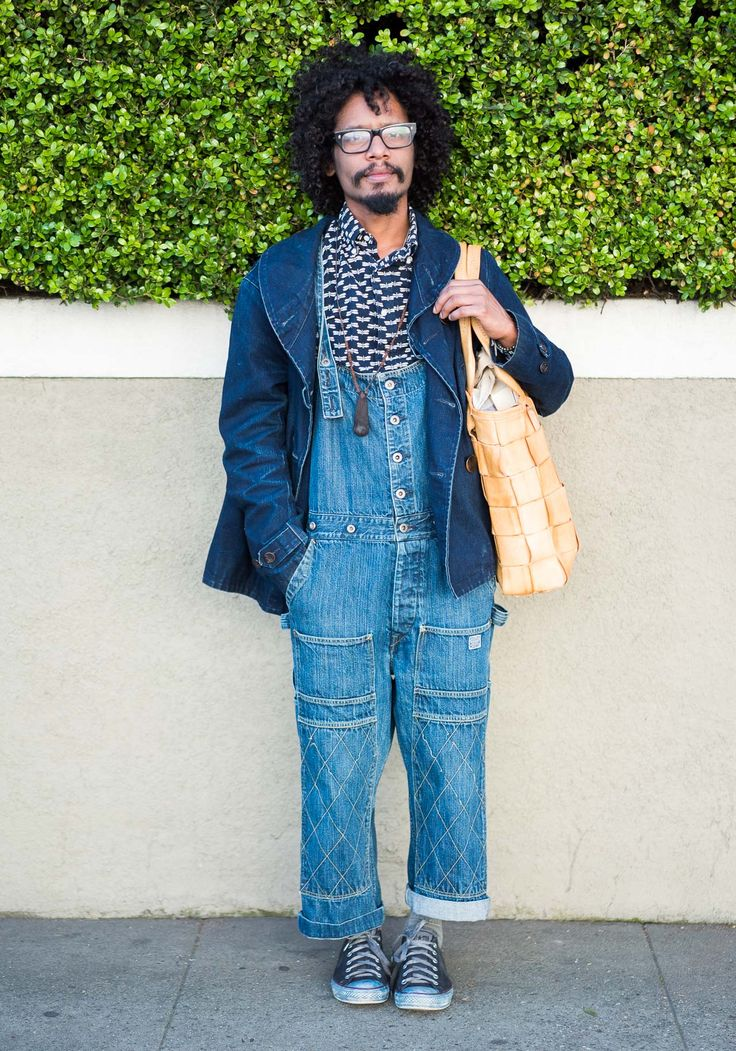 """Llane, 38""""Stylish revolutionaries and workers from all over the world inspire my style. I like to wear natural fabrics and try to go for timeless pieces. Now I'm wearing a Gitman Bros shirt, Kapital overalls, a Unionmade jacket, Muji tabi socks, over dyed indigo Converse shoes, and a leather bag by Eatable of Many Orders.""""Feb 16, 2015 ∙ Potrero Hill"""