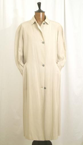 Original 1980's trench coat by Jean Paul Gaultier. Long, large, informal and very elegant. Color light beige
