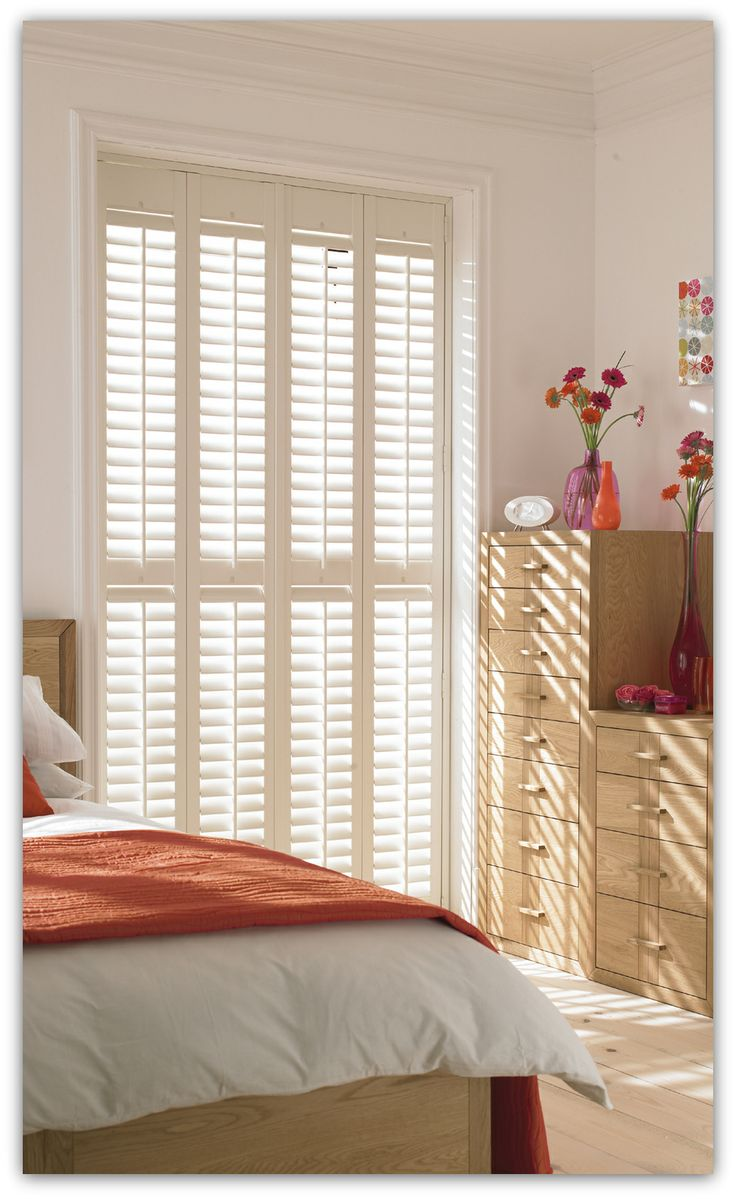 Full Length Plantation Shutters For Light Control And Privacy In The Bedroom