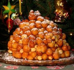 STRUFFOLI : TRADITIONAL ITALIAN PASTRY Lovely little balls of fried dough are dipped in honey, and piled into a mound. Sprinkled with powdered sugar, or tiny little candy sprinkles, this is a Christmas favorite, but served anytime.
