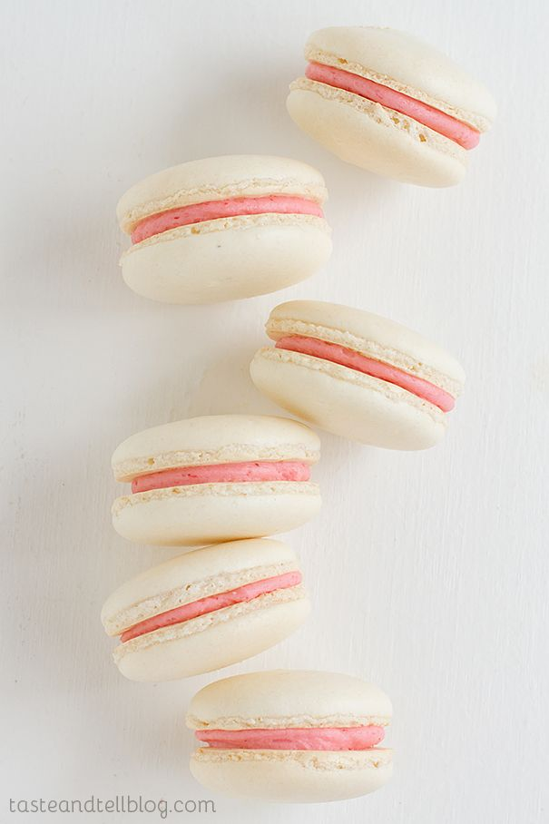 Strawberry Colada Macarons. These coconut macarons sandwich strawberry buttercream--yum!