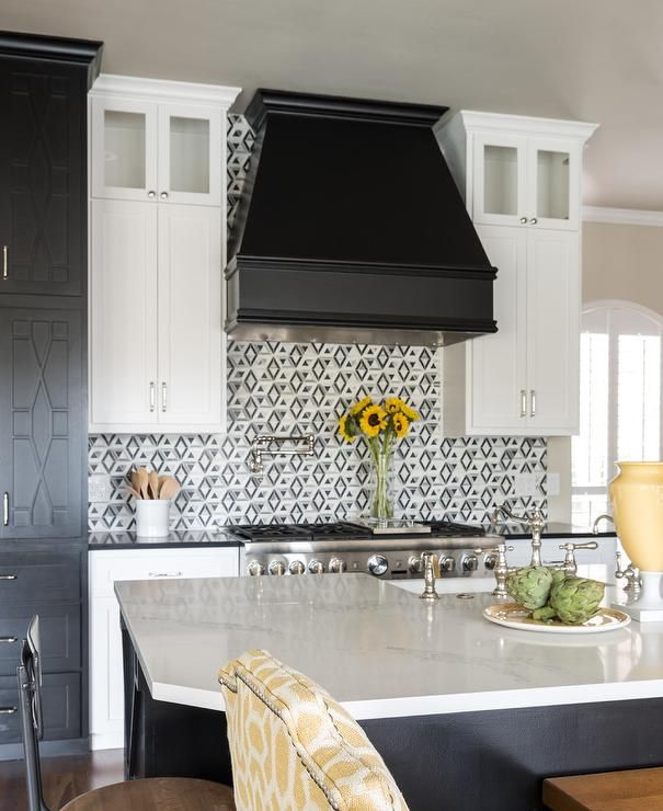 Wonderfully Appointed Black And White Kitchen Is Fitted With A Black Hood Fixed T Kitchen Cabinets Black And White Backsplash For White Cabinets Black Kitchens