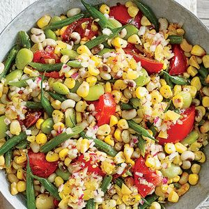 The acidity in this dish gives your palate a great reset that lets you enjoy the different levels of richness, fruitiness, and sweetness in the vegetables. Use cooked, undressed field peas from the Marinated Field Peas, or use the same method with butter beans, simmering 5 to 10 minutes longer.