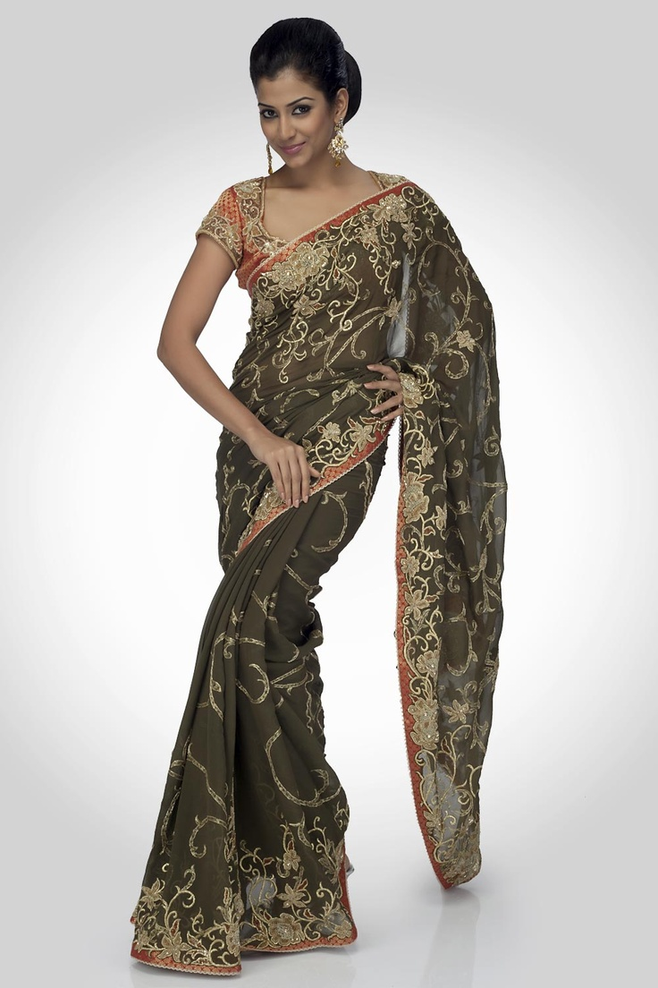 A shimmer georgette saree with delicate kasab floral embroidered borders and zardozi dabka highlights in an all over ornamental jaal, combined with a brocade blouse with floral embroidered neck and sleeves. An appropriate occasion wear ensemble.