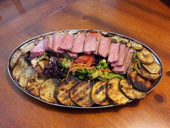 Pittsburgh-style Steak Salad made with Char-grilled Red Skin Potato and tossed with Chef Tim's Sweet Balsamic Vinaigrette