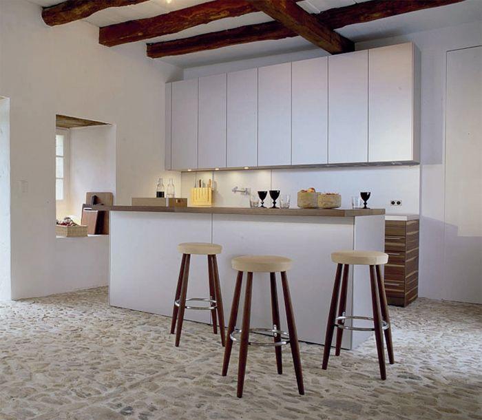 Modern Swedish country kitchen with rustic elements...amazing floor... Love the timber beams...Köksö - Sköna hem
