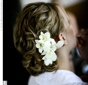 curly updo with small flowers