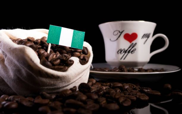 nigerian flag in a bag with coffee beans isolated on black background