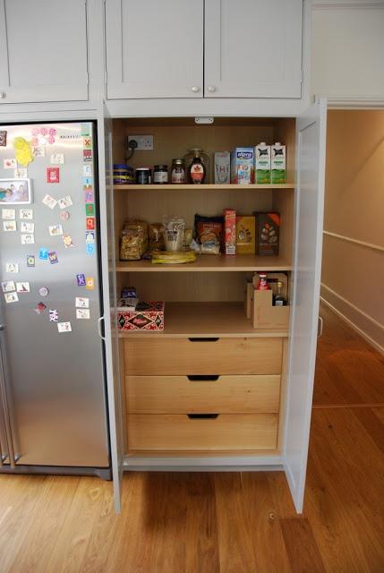 cabinets next to fridge
