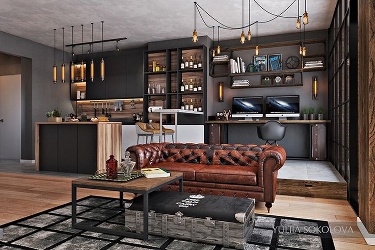 Loft em estilo industrial, piso em madeira,cozinha integrada, home office, sofá chesterfield em couro marron,iluminação com pendentes.