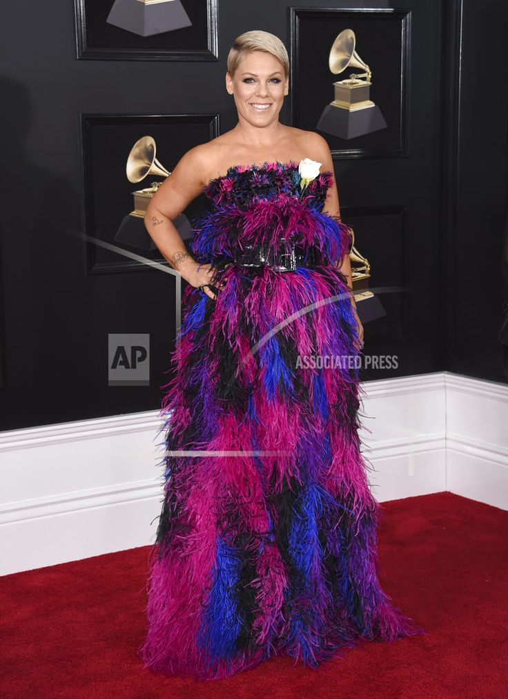 """NEW YORK /January 28, 2018 (AP)(STL.News) — The Latest on the 60th annual Grammy Awards being presented Sunday night in New York (all times local): ___ 6:50 p.m. Pink stood alone on the Grammy stage wearing jeans and a T-shirt to sing her new song """"Wild Hearts Can't Be B... Read More Details: https://www.stl.news/latest-pink-delivers-down-earth-grammys-performance/76351/"""