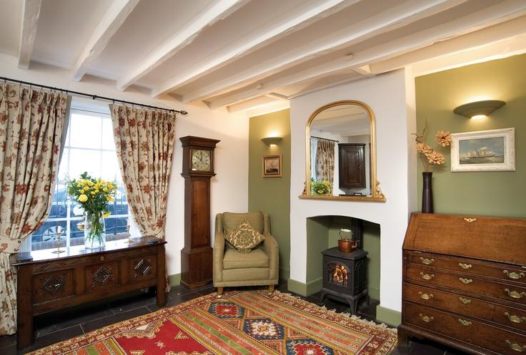 1780 Georgian town house, living room  #georgian #1780 #restoration #townhouse #home #livingroom #fireplace #rug #beam #green #english #renovation #historic #arundel #littlehampton #westsussex