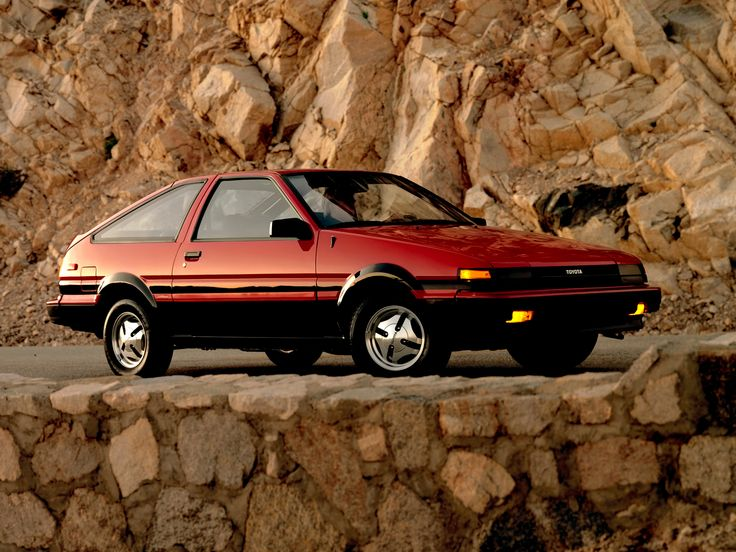 Toyota Corolla SR5 Sport Liftback 4 th car but in champagne with wide stripes and a shadow on back glass