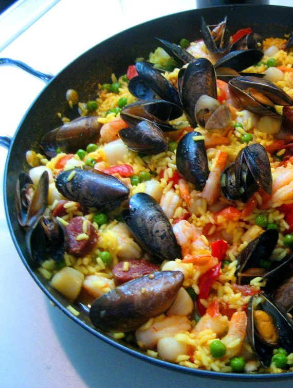 Seafood Paella:Ingredients: .75 pounds of shrimp .75 pounds of scallops .5 pounds of mussels 1 9 oz can of chopped clams 2 cups of rice 5 cups chicken broth 2 spanish chorizo 1 1/2 onions 3 garlic cloves, chopped 1 cup frozen peas 1 pimento, sliced 2 Roma tomatoes, chopped 1 1/2 tsp salt 1/2 tsp saffron 1 tbsp olive oil