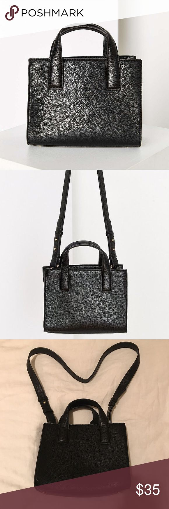 NWOT Urban Outfitters Structured Mini Tote Bag NWOT Urban Outfitters // Cooperative Structured Mini Tote Bag. Black vegan leather with texture. Long and short straps. Urban Outfitters Bags Crossbody Bags