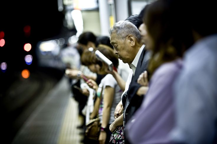 (A Japanese salaryman sleeps on a train platform in Tokyo.) Click-through for a slideshow of Shiho Fukada's photographs capturing the jobs crisis in Japan: http://nyr.kr/UCubH3