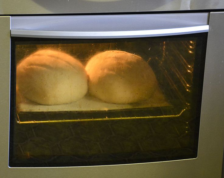 (13) Place in the oven. You need approx. 15min @ 240deg C. If your oven is fan forced, turn the tray around at the 10-15min mark so it also browns the cool side. This is the browning phase, so keep an eye on it. After about 10 mins you will notice the loaves have really 'puffed up' or 'sprung'. They will drop a little through the baking, don't worry.  After the 15min @ 240deg C, turn the oven down to 200-210deg C and leave for another 30 mins for large loaves. Small rolls, try 20 mins (Chris…